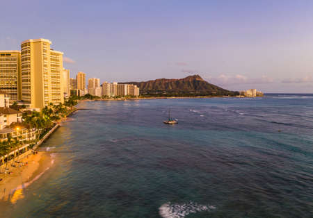 Aerial panorama of Waikiki beach and Diamond Head on Oahu, Hawaii at sunset