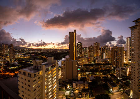 Dawn or sunrise behind the hotels and apartments in the modern part of Waikiki by the canal on Oahu 版權商用圖片