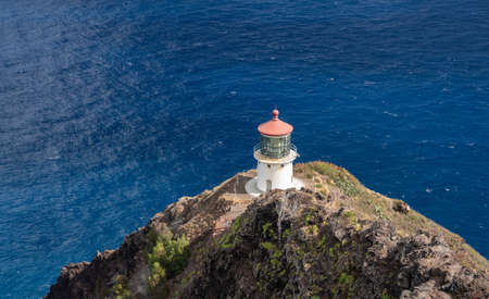 Old lighthouse on the cliff side on Makapu'u point on Oahu in Hawaii 版權商用圖片