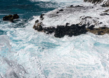 Foaming water on the shoreline of Kaena Point on the extreme west coast of Oahu in Hawaii