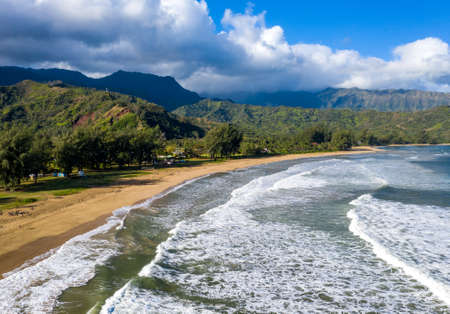 Aerial panoramic image at sunrise off the coast over Hanalei Bay and Waioli beach park on Hawaiian island of Kauai