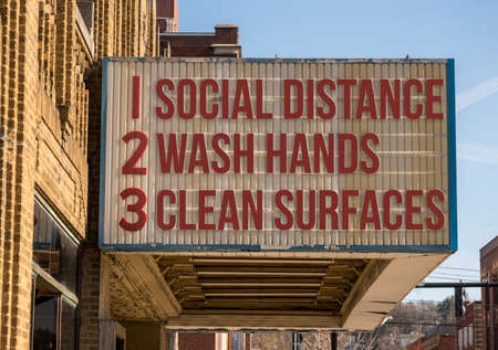 Movie cinema billboard with three basic rules to avoid the coronavirus or Covid-19 epidemic of wash hands, maintain social distance and clean surfaces