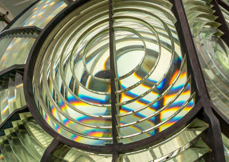 Close image of the glass prisms making up a fresnel lens in a lighthouse
