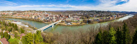Aerial wide panoramic view of the downtown area of Morgantown WV and campus of West Virginia University taken from a drone above the city