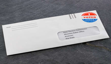 Envelope containing voting ballot papers being sent by mail for absentee vote in presidential election Banque d'images