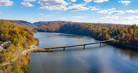 Aerial drone panorama of the autumn fall colors surrounding Cheat Lake and the Old Cheat Road bridge near Morgantown, West Virginia