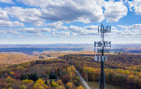 Aerial view of mobiel phone cell tower over forested rural area of West Virginia to illustrate lack of broadband internet service Stock Photo