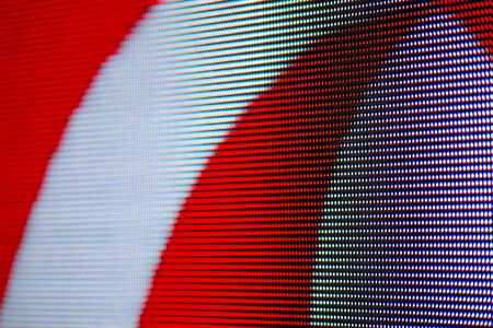 Red and White Curves Image on RGB LED Pixel Pitch - Color Mixing LEDS. Perspective view SMD Technology Screen Display Stock Photo