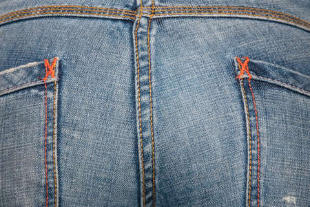 Ass girl dressed in blue jeans with pockets photo