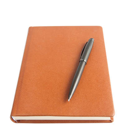 diary and a pen on a white background photo
