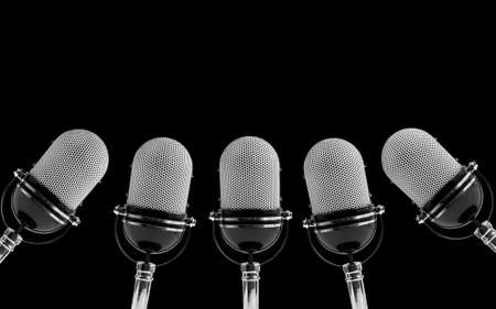 old microphone: five microphones on a black background
