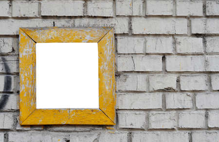 brick wall with a yellow frame photo