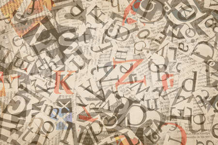 newsprint: letters cut from newspaper, background