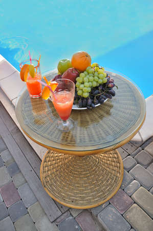 table with fruit by the pool photo