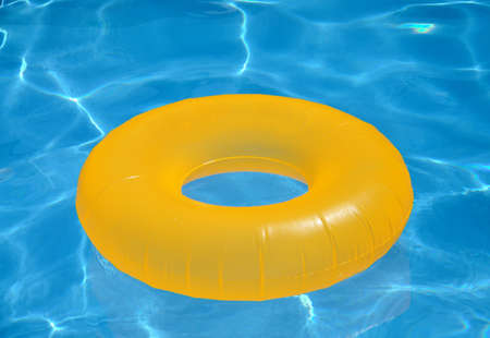 rubber ring: inflatable yellow circle in the pool