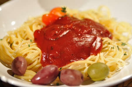 pasta with sauce and olives photo