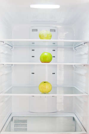 three apples in the refrigerator photo