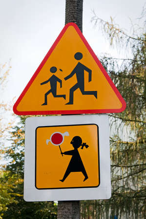 yellow road sign with children photo
