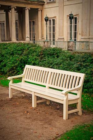 lazienki: white bench in the park
