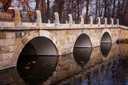 stone bridge over a pond photo