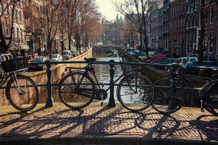 Bicycles parked on a bridge in Amsterdam photo