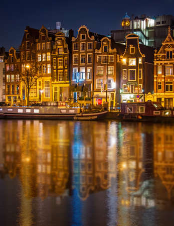house in Amsterdam at night photo