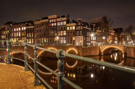 Canal in Amsterdam at night photo