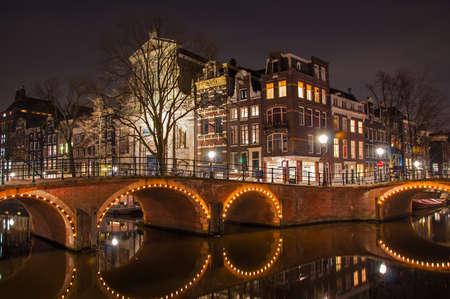 Canal in Amsterdam at night Stock Photo - 22630239