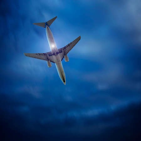 plane on a background of stormy sky