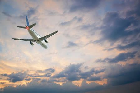 plane flying away against the sky