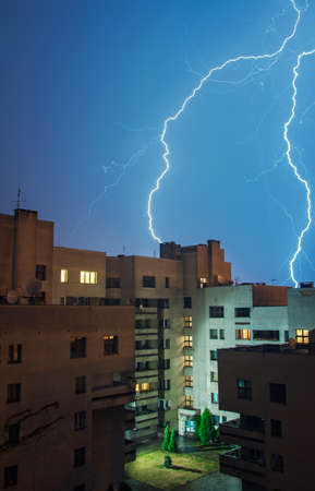 Lightning in the sky above the dwelling house