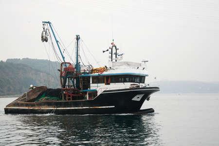 bosporus: black fishing boat on the Bosporus