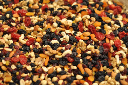 dry fruit: background of mixture of nuts and raisins Stock Photo