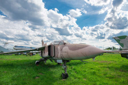 Military fighter plane on green grass