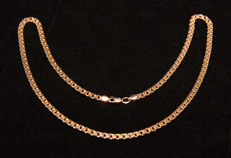 gold chain on a black background photo