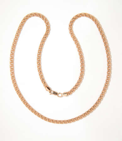 gold chain on a white background photo