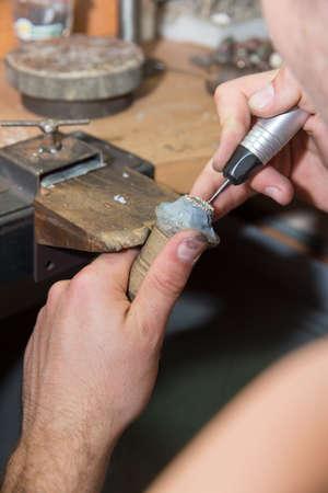 jeweler produces gold jewelry photo