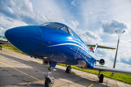 private parts: blue plane in the parking lot