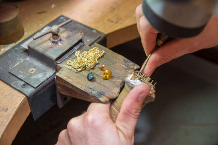 jeweller: jeweler fixes gems on gold product