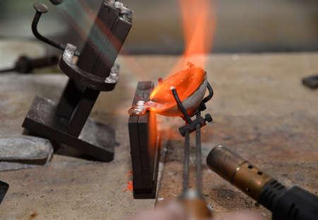jeweler melts precious metal burner