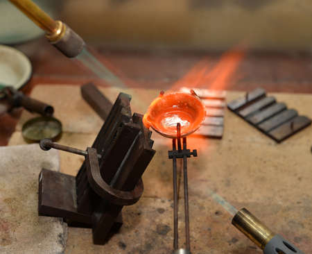 precious metal: jeweler melts precious metal burner