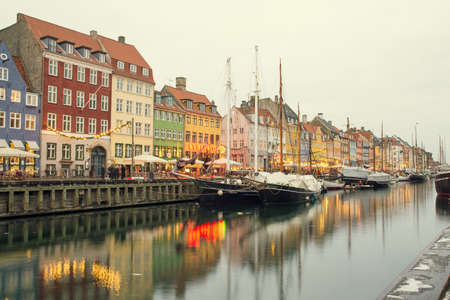 entertainment district: COPENHAGEN, DENMARK - 30 DECEMBER, 2014: Nyhavn is a 17th-century waterfront, canal and entertainment district in Copenhagen, Denmark. December 30, 2014 Copenhagen, Denmark.
