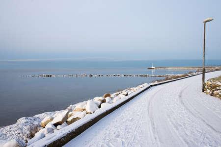 sweden in winter: Road near the sea in winter in Sweden