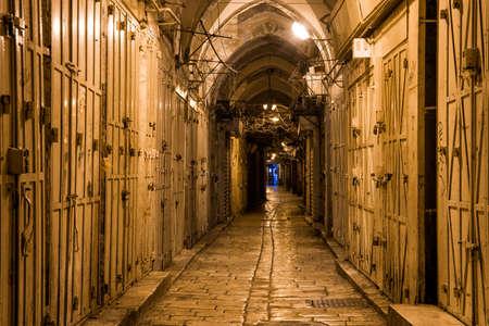 long narrow street in the Old City of Jerusalem Stock Photo