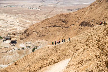 panoramic view: people are coming down from the mountain of Masada