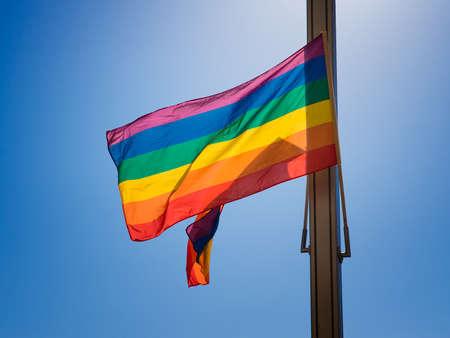 rainbow flag: Rainbow flag against the blue sky Stock Photo