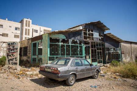 BETHLEHEM, PALESTINE - JUNE 2, 2015: Burnt building near The Israeli West Bank barrier. June 2, 2015