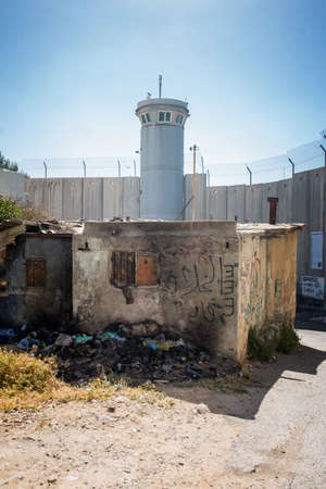 BETHLEHEM, PALESTINE - JUNE 2, 2015: The Israeli West Bank barrier  is a separation barrier. Upon completion, its total length will be about 700 kilometres. June 2, 2015. Bethlehem, Palestine. Banco de Imagens - 61756427