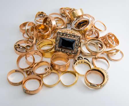 heap of gold jewelry on a white background Standard-Bild