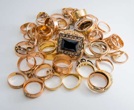 heap of gold jewelry on a white background Archivio Fotografico